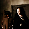 yunitsa: Sexby and Angelica from The Devil's Whore; 17th c. woman in dark cloak with man in hat behind her (Default)