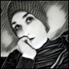 thedaughteroftyr: black and white image of myself wearing a knit hat looking pensive (Default)