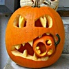 sage: a large jack-o-lantern chomping on a tiny jack-o-lantern (season: halloween)