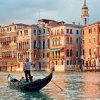 shopfront: Man and gondola on the water in Venice (Stock - [Venice] see the world)