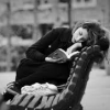 shopfront: Black and white, young woman curled up on park bench reading a book (Stock - reading any and everywhere)