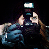 shopfront: Source: Man of Steel. Lois in winter gear with camera held up to her face (DC - [Lois] snap all the pictures)