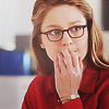 shopfront: Source: Supergirl. Kara looking concerned with hand held to her lips. (Supergirl - [Kara] super-oops)