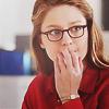 shopfront: Source: Supergirl. Kara looking concerned with hand held to her lips. (Supergirl - [Kara] super-oops)