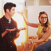 shopfront: Source: Supergirl. Kara presenting Barry to people with ta-da flourish of her arms (Supergirl - best of smiley superfriends)