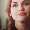 shopfront: Source: Teen Wolf. Close up of Lydia smiling with her chin raised. (SV - Chloe has the sexiest grin)