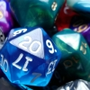 toffeecat: blue D20 laid on top of my dice pile (shinydice001)