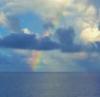 lovablestories: a rainbow over a blue ocean (write: rainbow)
