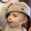 rosefox: An adorable white toddler wearing an adult's grey flatcap ()