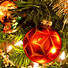 fueschgast: Artwork from the MK Ultra page of The Resistance booklet superimposed on a bauble hanging on a tree. (non-fandom: Christmas (Muse))