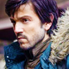 anghraine: cassian andor in profile, wearing a blue parka (cassian [parka])