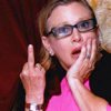eruthros: Carrie Fisher flipping the bird and looking surprised (Carrie Fisher - flipping someone off ast)