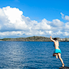 naye: blue sea, fluffy summer clouds, a figure leaping into the water (jump in!)
