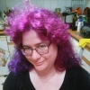 artsyhonker: a girl with glasses and purple shoulder-length hair (purple hair)