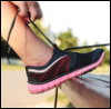 longficmod: Photo of a woman tying a running shoe (Default)