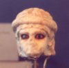 katzenfabrik: The head of a statue of the goddess Ningal, in white stone with strikingly outlined eyes. (goddess, statue, ningal)