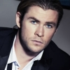lessthanaman: Chris Hemsworth sitting at an angle in a rumpled tux with an uneasy expression (uneasy)