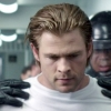 lessthanaman: Chris Hemsworth looking down with black gloved hands on his shoulders (status:poor)