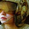 anaraine: Crop of Rey, wearing a battered flight helmet and peering off into the distance. ([star wars] flight helmet)