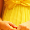 marika_kailaya: close-up of a girl in a yellow dress with a bow, her hands folded before her (Default)
