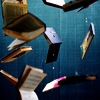 candesco: books falling through the air on a blue background (books)