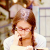 talibusorabat: A young white woman with brown braids reading (Angel: Fred reading)