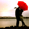 zaubra: (kissing under red umbrella)