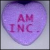 angelicmobster8: a heart shaped candy saying a.m. inc. (AM inc)