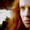arcadiaego: Close up of a young, red headed woman with a serious expression. (Lizzie)