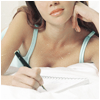 arcadiaego: A young woman writing while lying on a bed (Writing)