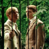 arcadiaego: Two young white men standing in a garden behind the bars of a gate (Brideshead)