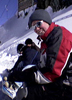 juliet: Me sat on the side of a mountain with my snowboard, all bundled up in boarding kit (snowboarding)
