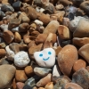 ilikecats: white pebble on beach with drawn on smiley face (pebble)