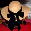willowmeg: The back of my head, in a ribboned straw hat. (hat)