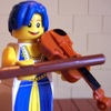 sweetmusic_27: A lego minifig in a blue dress with blue hair and a fiddle. (Lego fiddler)