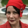 marianme: Portrait of me wearing bright red 1920s hat (1920s Red Hat)