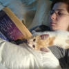 alexmegami: me reclining and reading with the cat lying on my chest (cat, reading)
