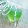 nestar: (green bottle and pearls)