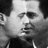 kissmeprobie: close up of tony whispering to tim (tim tony black and white)