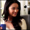 impy: Pretty Little Liars Emily holding a coffee mug, looking super sweet. (PLL: Emily Sweet)