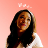 noblealice: iris west against a pink background with hearts (mov:avenge:love is a child's game)