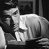 muccamukk: Gregory Peck looks up from the book he's reading. (Books: Hello Reading)