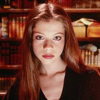 hermionesviolin: photoshoot image of Michelle Trachtenberg (who plays Dawn in the tv show Buffy) looking seriously (angrily?) at the viewer, with bookshelves in the background (angry - books)