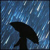 hermionesviolin: silhouette of a figure holding an umbrella while rain falls (rain)