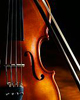 hermionesviolin: close up of a violin, with a bow in the background (violin)