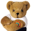 hermionesviolin: a build-a-bear, facing the viewer, with a white t-shirt and a rainbow stitched tattoo bicep tattoo (pride)