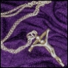 wildeabandon: crucifix necklace on a purple background (religion)