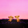 ada_hoffmann: cartoon of two lion cubs poking their heads above the grass nervously (nervous - cubs)