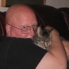 blackleatherbookshelf: (me and the puss)