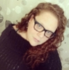 femmasaurusrex: Photograph of a woman with long curly hair wearing glasses and a bulky sweater (blind)